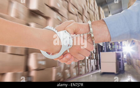 Composite image of handcuffed business people shaking hands - Stock Photo