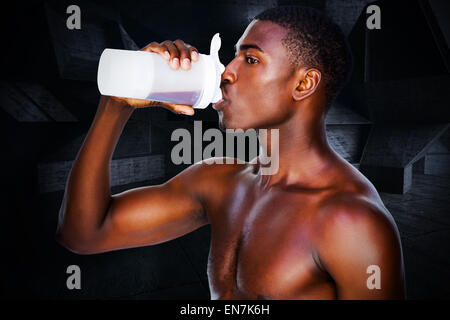 Composite image of side view of a sporty man drinking protein - Stock Photo