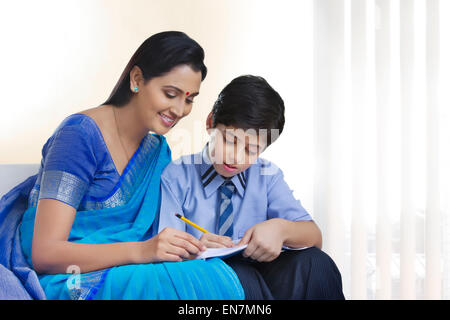 Mother helping son study - Stock Photo