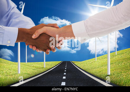 Composite image of close-up shot of a handshake in office - Stock Photo