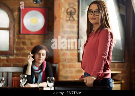 Two girlfriends in a pub having a girls only date - Stock Photo