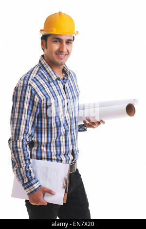 Portrait of smiling contractor holding blueprint and clipboard - Stock Photo
