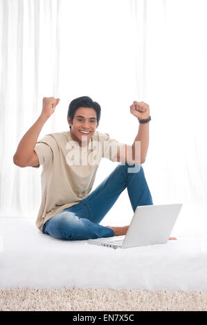 Portrait of young man rejoicing - Stock Photo