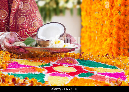 Close-up of a Brides hand holding pooja thali - Stock Photo