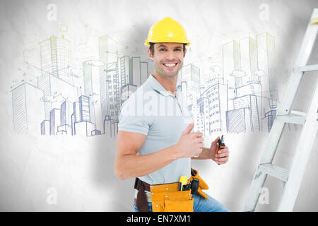 Composite image of technician with tools showing thumbs up by step ladder - Stock Photo