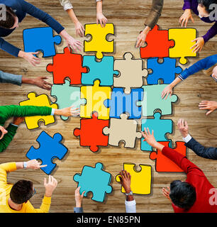 Group of Diverse People with Jigsaw Puzzle Pieces Concept - Stock Photo