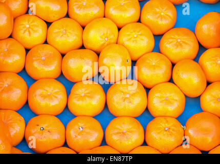 A background of clementines seen on a market - Stock Photo
