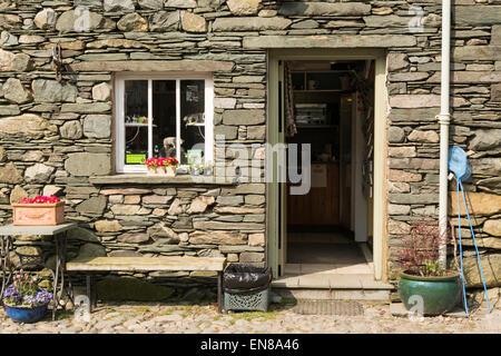 ROSTHWAITE, BORROWDALE, LAKE DISTRICT, CUMBRIA, ENGLAND, UK - 9 APRIL 2015: Entrance to Flock-in walkers Tea Room, - Stock Photo