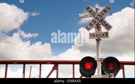 A train trips the signal while switching cars in a Texas town - Stock Photo