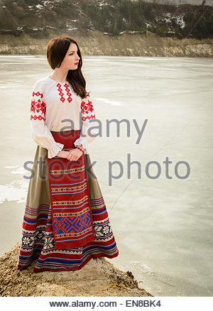 young woman in a Slavic Belarusian national original suit outdoors - Stock Photo
