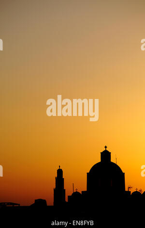 Silhouette of Orthodox Church in Santorini, Greece - Stock Photo