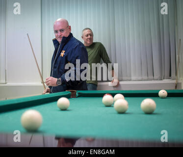 Expedition 43 NASA Astronaut Scott Kelly, left, plays pool with Russian Cosmonaut Mikhail Kornienko of the Russian - Stock Photo