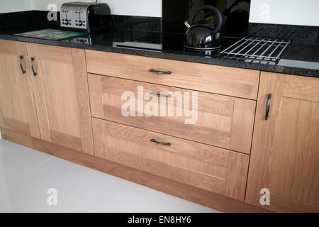 brand new kitchen cabinets and granite worktops in a new build property in the uk - Stock Photo