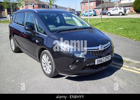 vauxhall safira mpv parked on double yellow lines in residential area of england uk - Stock Photo