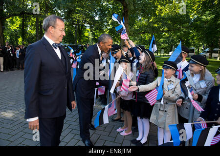 President Barack Obama, with President Toomas Hendrik Ilves of Estonia, greets students during an official arrival - Stock Photo