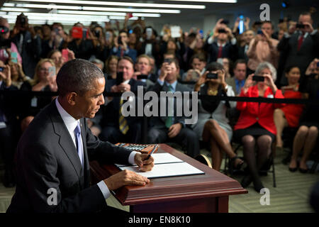President Barack Obama signs Executive Order 'Improving the Security of Consumer Financial Transactions,' at the - Stock Photo
