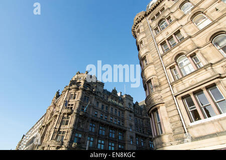 Typical Princes Street architecture with the Jenners department store in Edinburgh, Scotland - Stock Photo