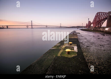 Forth rail and road bridges from the harbour jetty in South Queensferry, Edinburgh, midlothian, Scotland - Stock Photo