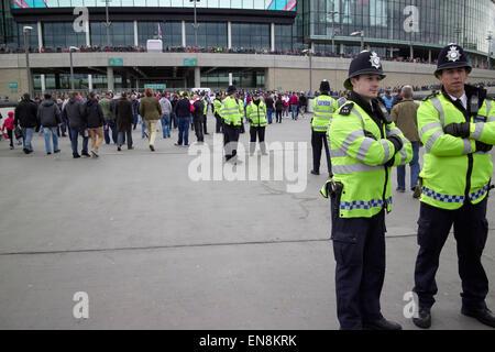 policing outside Wembley stadium on game day London UK - Stock Photo