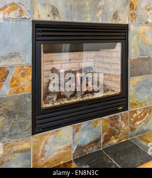 Slate surround gas fireplace in the living room of a Craftsman Style residential home in Colorado, USA - Stock Photo
