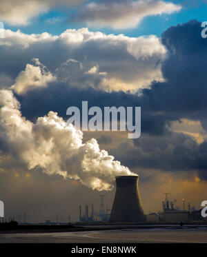 Cooling Towers of  Doel Belgium Nuclear Plant Doel in the Port of Antwerp View across the river Scheldt under dramatic - Stock Photo