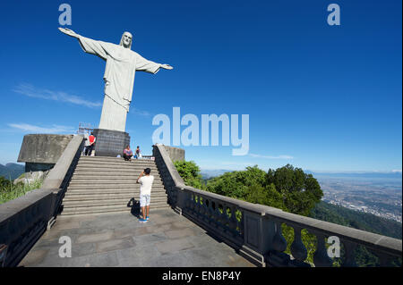 RIO DE JANEIRO, BRAZIL - MARCH 05, 2015: The first group of tourists arrive at the Statue of Christ the Redeemer - Stock Photo