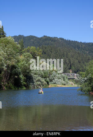 People canoeing on the Russian River near Guernville in Northern California. - Stock Photo