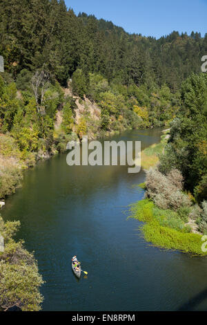 People in a canoe, photographed from above on the Russian River near Guernville in Northern California. - Stock Photo