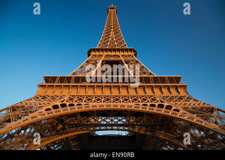 Glow of sunset on the Eiffel Tower, Paris, France - Stock Photo
