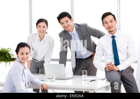 Business men and women working in the Office - Stock Photo