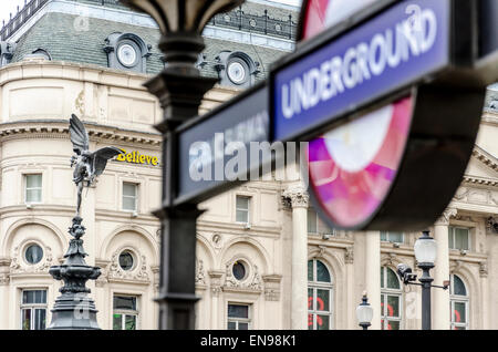 Shaftesbury Memorial Fountain (Eros statue) with the London Underground sign. - Stock Photo