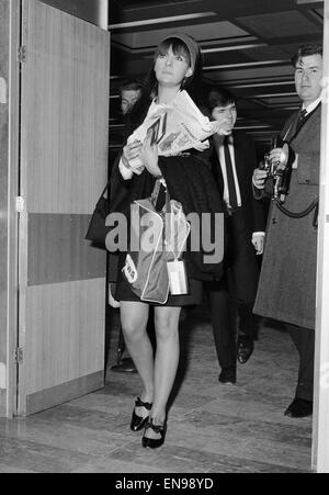 Chrissie Shrimpton, girlfriend of Mick Jagger of The Rolling Stones, flying out to join him at the end of their - Stock Photo