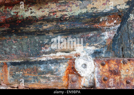 Layers of paint on the hull of an old fishing boat. - Stock Photo