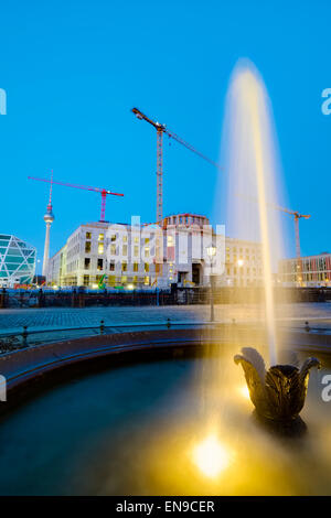 Fountain in front of building site Berlin Palace, Berlin, Germany - Stock Photo