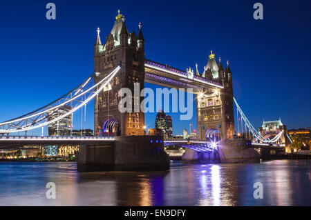 A night-time view of Tower Bridge and the River Thames in London. - Stock Photo