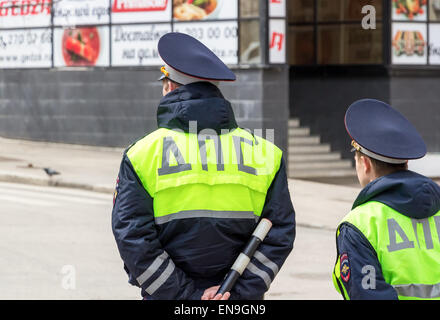 Russian police officers standing by the road in lime-colored uniform