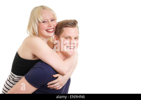 young couple piggyback - Stock Photo