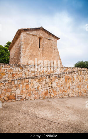 Saint Michael church in Calafell town, Spain. It is a work of transaction from Romanic to Gothic style - Stock Photo