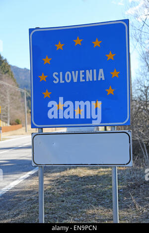 blue road sign with yellow stars in the border area between slovenia and other country - Stock Photo