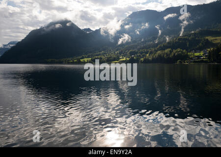view over the lake and reflections of wafts of mist in Grundlsee after the rain, Styria, Austria - Stock Photo