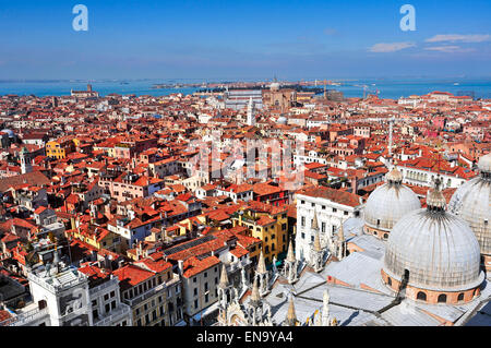 aerial view of the Patriarchal Cathedral Basilica of Saint Mark and the roofs of Venice, Italy - Stock Photo