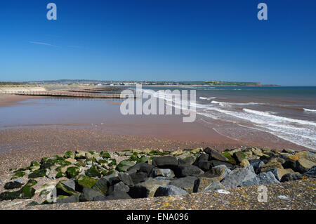 Wide beach and groynes at Dawlish Warren, with Exmouth and the Exe Estuary in the distance, Devon, England, UK - Stock Photo