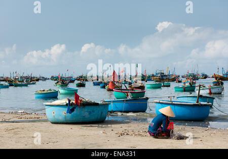 Mui Ne Fishing Village and Traditional Fishing Boats - Stock Photo