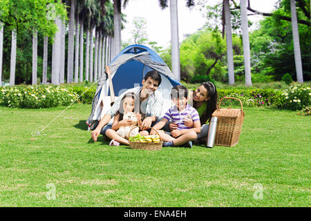 indian Parents and kids  park Picnic enjoy - Stock Photo