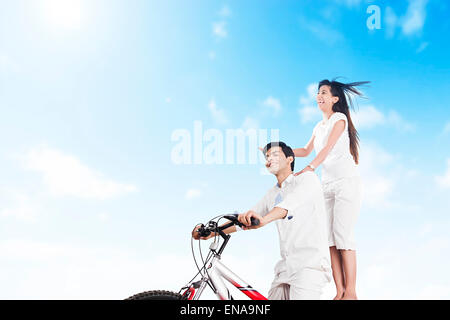 2 indian Married Couples Riding Cycle - Stock Photo