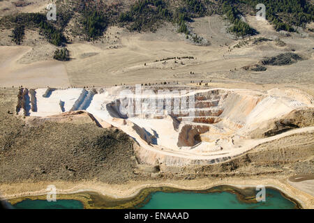 An aerial view of the tiers and levels of excavation in an open pit phosphate mine. - Stock Photo