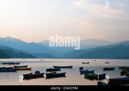 Phewa Lake was slightly enlarged by damming. It is in danger of silting up because of the inflow during the monsoon - Stock Photo