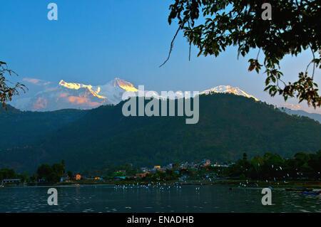 Annapurna range from Phewa lake, Pokhara, Nepal. - Stock Photo