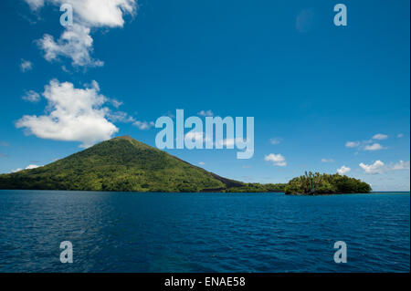 The active island volcano of Banda in the Maluku province Indonesia - Stock Photo