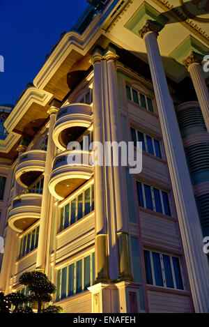 Apartment block lit at night and viewed from below. - Stock Photo